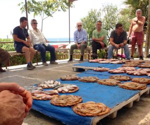 yok Montgat singing fish auction